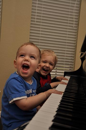 Jackson & Carter playing piano