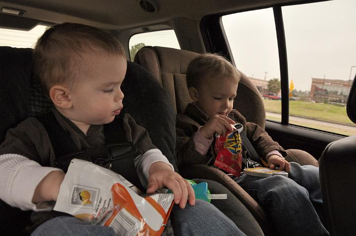 Jackson & Carter eating Snacks in the Car