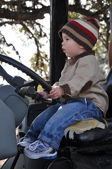 Jackson driving the tractor