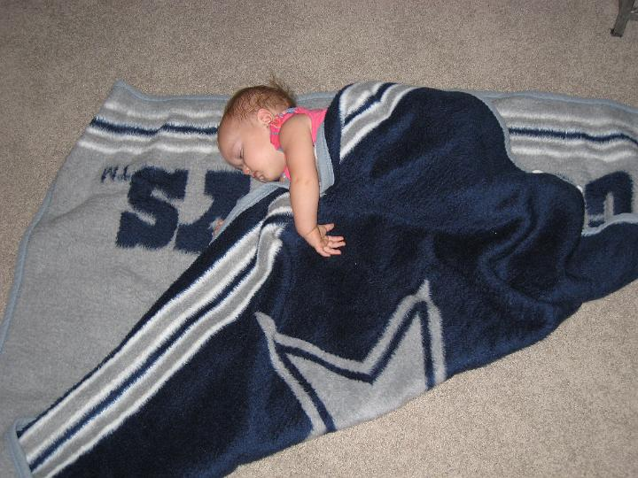 Paige Cathey sleeping on Cowboys blanket