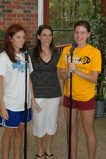 Jessie, E, and Julia singing
