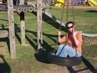 E on the tire swing
